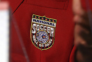 30 May 2012: The Hall of Fame crest on 2012 Inductee Desmond Armstrong's red jacket. The 2012 National Soccer Hall of Fame Induction Ceremony was held at Fedex Field in Landover, Maryland before a men's international friendly soccer match between the United States and Brazil.