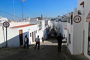 Alleyway down hill village whitewashed houses Vejer de la Frontera, Cadiz Province, Spain