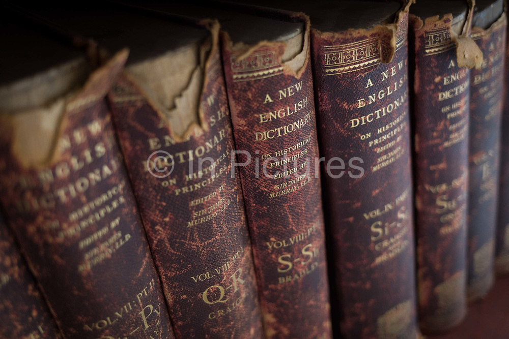 Antiquarian copies of The New English Dictionary on Historical Principles edited by Sir James Murray, line shelves in the Lee Library of the British Academy, on 17th September 2017, at 10-12 Carlton House Terrace, in London, England. Sir James Augustus Henry Murray 1837-1915 was a Scottish lexicographer and philologist. He was the primary editor of the Oxford English Dictionary OED from 1879 until his death.