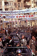 A 28.4 MG IMAGE OF:.President Jimmy Carter and President Anwar Sadat of Eqypt  wave in a parade in alexandria, Egypt.  Photo by Dennis Brack