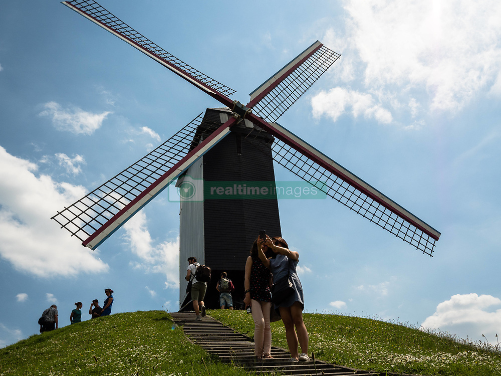 May 27, 2017 - Bruges, Belgium - Bruges, Belgium, on 27th May 2017. During one of the warmest days of the year, Bruges was the destination chosen by thousands of tourists from all around the world. This is the capital and largest city of the province of West Flanders in the Flemish region of Belgium, in the northwest of the country. With Bruges being a huge tourist destination, tourists have a lot of choices to enjoy the city, like horse-drawn carriage tours, canal tours by boat, or just walk around the historic city center. (Credit Image: © Romy Arroyo Fernandez/NurPhoto via ZUMA Press)