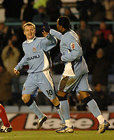 Fotball<br /> FA Cup England 2004/2005<br /> 3. runde<br /> 08.01.2005<br /> Foto: SBI/Digitalsport<br /> NORWAY ONLY<br /> <br /> Coventry City v Crewe Alexandra<br /> <br /> Linesman Rob Lewis, who was at the centre of the furore at Coventry's Gary McSheffrey (L) celebrates giving his side a 3-0 lead and his second goal of the match with Stern John
