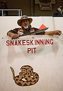 SWEETWATER, TX - MARCH 14: A Jaycees volunteer snake handler waits for more western diamondback rattlesnakes brought in by hunters during the 51st Annual Sweetwater Texas Rattlesnake Round-Up, March 14, 2009 in Sweetwater, Texas. Approximately 24,000 pounds of rattlesnakes will be collected, milked for venom and the meat served to support charity. (Photo by Richard Ellis)