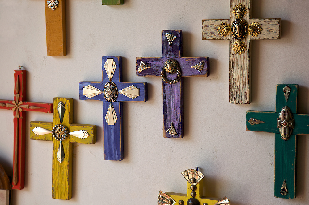 Colorful crosses make decorative wall art at a shop along the Turquoise Trail in Madrid, New Mexico.