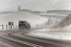 © Licensed to London News Pictures. 30/01/2021. Llanfihangel Nant Melan, Powys, Wales, UK. Motorists drive through a blizzard on the A44 road near Llanfihangel nant Melan in Powys, Wales, UK. Photo credit: Graham M. Lawrence/LNP