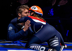 13-01-2019 NED: ISU European Short Track Championships 2019 day 3, Dordrecht<br /> Suzanne Schulting of Netherlands kissing her friend Sebastiaan Middelkoop after finishing first in the Ladies 3000m super final during the ISU European Short Track Speed Skating Championships.