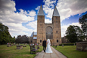 Bride and her father approach Southwell Minster
