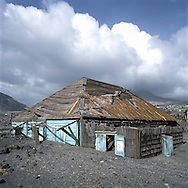 The former capital of Montserrat, Plymouth, which is now covered under a layer of ash, mud and rock from the eruption of the Soufriere Hills volcano over the last 10 years. The area is out of bounds to everyone except scientists. Photo shows destroyed buildings..Photo©Steve Forrest/Workers Photos