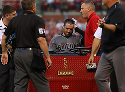 July 28, 2017 - St. Louis, MO, USA - Arizona Diamondbacks pitcher Robbie Ray keeps pressure on his head before being carried from the field after getting hit in the head by a ball hit by the St. Louis Cardinals' Luke Voit in the second inning at Busch Stadium in St. Louis on Friday, July, 26, 2017. The Cards won, 1-0. (Credit Image: © Christian Gooden/TNS via ZUMA Wire)