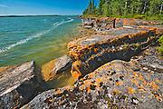 Lichen covered limestone rocks on shore of Rocky Lake<br />Rocky Lake<br />Manitoba<br />Canada
