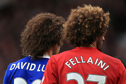 16th April 2017 - Premier League - Manchester United v Chelsea - The large afro hairstyles of David Luiz of Chelsea (L) and Marouane Fellaini of Man Utd - Photo: Simon Stacpoole / Offside.
