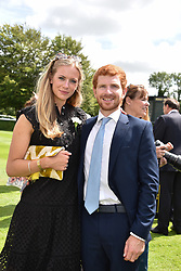29 July 2021 - The QATAR Goodwood Festival Ladies Day at Goodwood Racecourse, West Sussex.<br /> Picture Shows - Michael Macpherson and Isabel Anderson.<br /> <br /> NON EXCLUSIVE - WORLD RIGHTS