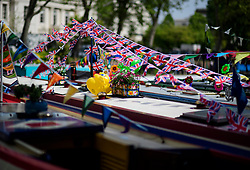 © Licensed to London News Pictures.30/04/2017.London, UK. Union flag bunting on the roof of a narrowboat as the Canalway Cavalcade festival takes place in Little Venice, London on Saturday, 30 April 2017. Inland Waterways Association's annual gathering of canal boats brings around 130 decorated boats together in Little Venice's canals on May bank holiday weekend. Photo credit: Ben Cawthra/LNP