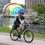 A City of Orlando bicycle police officer patrols Lake Eola park on Monday, March 30, 2020 in Orlando, Florida. (Alex Menendez via AP)