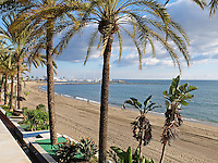 Winter sunshine, blue skies and a mild temperature makes Marbella, Malaga, Spain, Espana, a popular winter holiday destination, 201412150233<br />