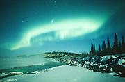 Alaska. Big Delta. The comet Hale-Bopp shines brightly through northern lights over the Delta River.