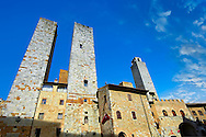 The so called twin towers of Sangimignano built in the 13th century as defensive towers and also to show prestige and wealth. The Council of San Gimignano ruled that no tower should be built higher than that of the town Hall of San Gimignano so this family built two towers to be ahead of its opposition. A UNESCO World Heritage Site. San Gimignano; Tuscany Italy .<br /> <br /> Visit our ITALY PHOTO COLLECTION for more   photos of Italy to download or buy as prints https://funkystock.photoshelter.com/gallery-collection/2b-Pictures-Images-of-Italy-Photos-of-Italian-Historic-Landmark-Sites/C0000qxA2zGFjd_k<br /> If you prefer to buy from our ALAMY PHOTO LIBRARY  Collection visit : https://www.alamy.com/portfolio/paul-williams-funkystock/sangimignano.html