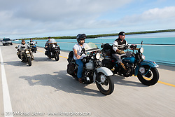 Rodney Sterling  (L) and Chris Tribbey ride side by side through the Florida Keys during the Cross Country Chase motorcycle endurance run from Sault Sainte Marie, MI to Key West, FL. (for vintage bikes from 1930-1948). Stage-10 covered just 110 miles from Miami to the finish in Key West, FL USA. Sunday, September 15, 2019. Photography ©2019 Michael Lichter.