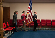 (From right to left) Connor Lenigar, Henry Maxwell, Ekhan Browning, and Cameron Leery practice a flag presentation during a Tri-Rivers Chapter DeMolay meeting at the Athens Masonic Lodge in Athens, Ohio.