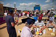 London, UK. Thursday 9th August 2012. London 2012 Olympic Games Park in Stratford. Food / eating area where people have picnic benches to rest and eat their McDonalds lunch on.