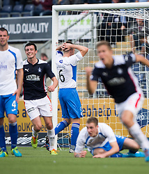 Queen of the South's Chris Higgins (6) scores an own goal.<br /> Falkirk 1 v 1 Queen of the South, Scottish Championship game played today at The Falkirk Stadium.