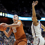UNCASVILLE, CONNECTICUT- DECEMBER 4: Kelsey Lang #40 of the Texas Longhorns drives to the basket while defended by Gabby Williams #15 of the Connecticut Huskies during the UConn Huskies Vs Texas Longhorns, NCAA Women's Basketball game in the Jimmy V Classic on December 4th, 2016 at the Mohegan Sun Arena, Uncasville, Connecticut. (Photo by Tim Clayton/Corbis via Getty Images)