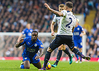 Football - 2016 / 2017 Premier League - Tottenham Hotspur vs. Leicester City<br /> <br /> Kyle Walker of Tottenham clears the ball in front of Jeffrey Schlupp of Leicester City who took the ball hard in the chest at White Hart Lane.<br /> <br /> COLORSPORT/DANIEL BEARHAM