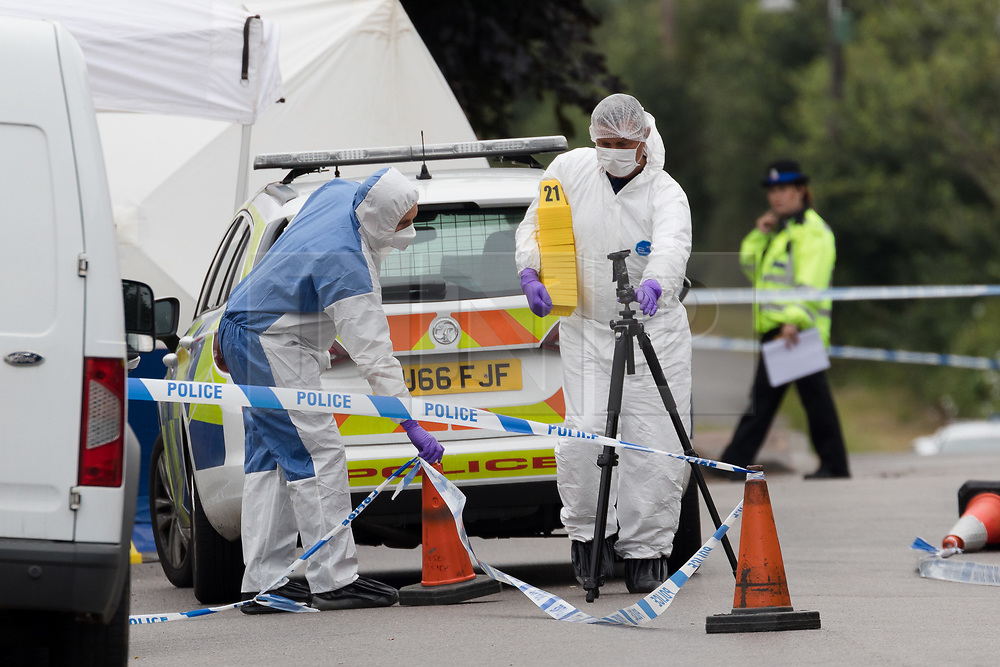 © Licensed to London News Pictures. 01/07/2017. GRAYS, Essex, UK.  Forensic officers working within the police cordon at Blackshots Lane in Grays, Essex. A man has died after being stabbed and three others have life threatening injuries following a street fight in Blackshots Lane, Grays, Essex last night.  Photo credit: Vickie Flores/LNP