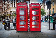 Typical red phone booths in the city of London