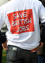 """© licensed to London News Pictures. LONDON, UK.  07/09/11. A man wear a t-shirt that says """"Save British Jobs'.  A large group of Unite members working at Bombardier, along with business leaders and Derby councillors call on the government to """"save British train manufacturing"""" outside parliament today. The delegation's visit, which coincides with the Transport Committee hearing, includes Unite general secretary Len McCluskey, the leader of Derby City Council and the Mayor of Derby.. Mandatory Credit Stephen Simpson/LNP"""