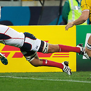 JJ Gagiano, USA, scores a try for his side as he avoids the challenge of Rocky Elsom, Australia, during the Australia V USA, Pool C match during the IRB Rugby World Cup tournament. Wellington Stadium, Wellington, New Zealand, 23rd September 2011. Photo Tim Clayton..