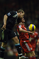 Photo: Paul Greenwood.<br />Liverpool v Manchester City. The Barclays Premiership. 25/11/2006. Manchester City's Ben Thatcher beats Liverpool's Robbie Fowler in the air
