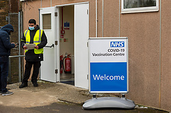 © Licensed to London News Pictures. 11/02/2021. WATFORD, UK. A patient checks in the entrance to a new Covid-19 vaccine centre at Watford Town Hall.  Watford Borough Council has worked closely with the NHS, to adapt the one level extension to the Town Hall for its new role.  Vaccines are administered on an appointment only basis as the UK government attempts to reach its target of 15 million vaccines administered by 15 February.   Photo credit: Stephen Chung/LNP
