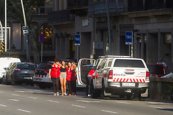 A woman is helped by Spanish Red Cross after a van ploughed into the crowd, killing 13 persons and injuring over 80 on the Rambla in Barcelona, Spain on August 17, 2017. A driver deliberately rammed a van into a crowd on Barcelona's most popular street on August 17, 2017 killing at least 13 people before fleeing to a nearby bar. Officers in Spain's second-largest city said the ramming on Las Ramblas was a 'terrorist attack'.  (Photo by Hugo Fernández Alcaraz/NurPhoto/Sipa USA)