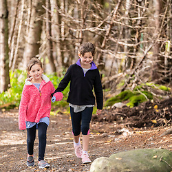 Two sisters walk on a trail at Quoddy Head State Park in Lubec, Maine.