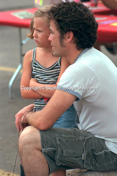 Dad and angry daughter ages 26 and 7. Cedarfest Summer Music Festival Minneapolis  Minnesota USA