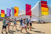Heading for the Arena in hot sun - The 2018 Latitude Festival, Henham Park. Suffolk 15 July 2018