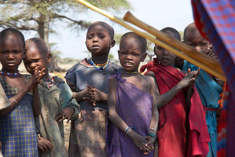 Maasai children gathered in tribal village near the Olduvai Gorge, Tanzania