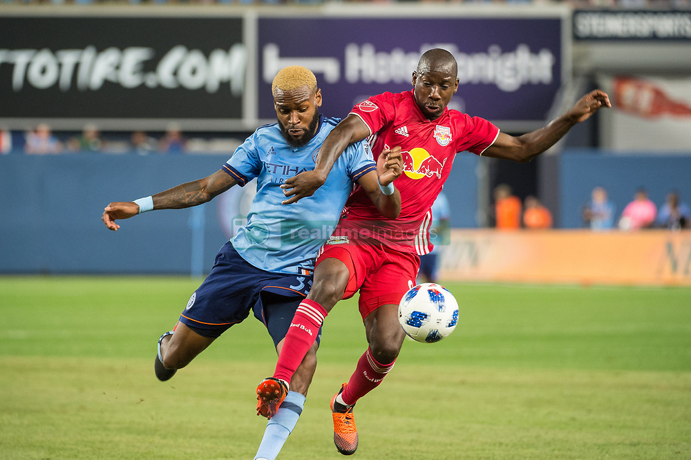 August 22, 2018 - Bronx, New York, United States - New York City defender SEBASTIEN IBEAGHA (33) fights for the ball against New York Red Bulls forward BRADLEY WRIGHT-PHILLIPS (99) during a regular season match at Yankee Stadium. New York City FC tie the New York Red Bulls 1 to 1 (Credit Image: © Mark Smith via ZUMA Wire)