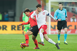 March 27, 2018 - Chorzow, Poland - Woo-young Jung (KOR) vies Robert Lewandowski of Poland   during the international friendly soccer match between Poland and South Korea national football teams, at the Silesian Stadium in Chorzow, Poland on 27 March 2018. (Credit Image: © Foto Olimpik/NurPhoto via ZUMA Press)