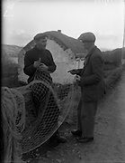 26-29/01/1960<br /> 01/26-29/1960<br /> 26-29 January 1960<br /> Gael-Linn Special at Gweedore and Teelin Co. Donegal. Two men mend nets by a thatched cottage.