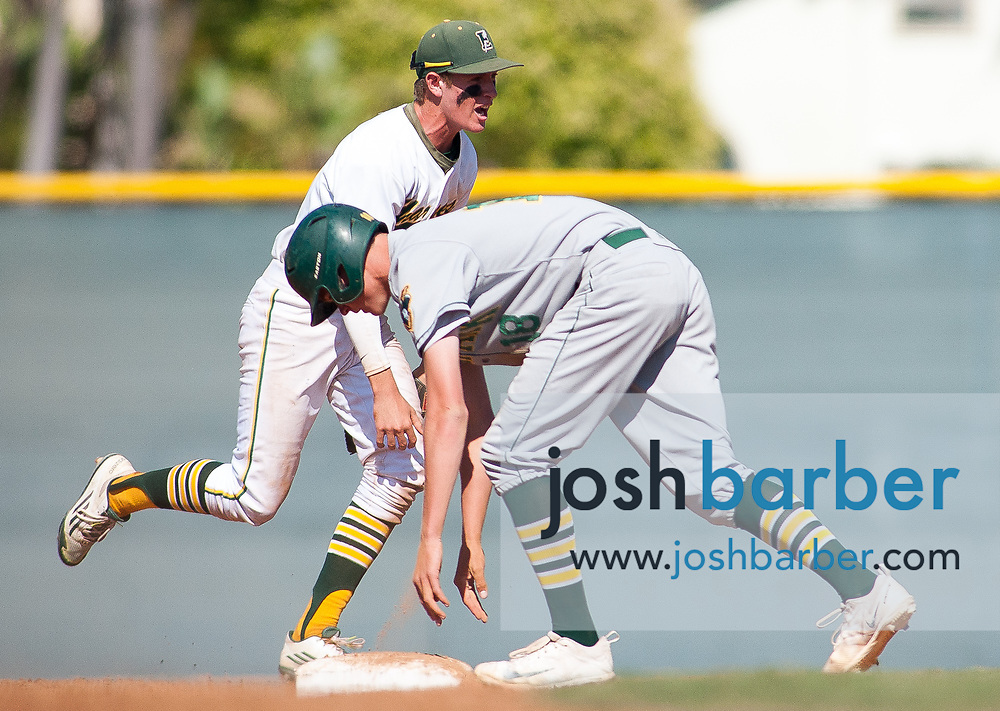 Edison's Ted Burton (5) celebrates after he managed to throw the forecourt to the second baseman from the ground to get out Moorpark's Dillon Holliday (18) during a CIF-SS Division 2 second round game at Edison High School on Tuesday, May 23, 2017 in Huntington Beach, California. (Photo/Josh Barber)