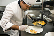Head chef at the Park Hotel, Anurudh Khanna prepares a dish of shahi paneer in the kitchens, New Delhi, India.