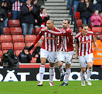 Fotball<br /> England<br /> Foto: Fotosports/Digitalsport<br /> NORWAY ONLY<br /> <br /> Stoke City v Sunderland Premiership 05.02.11<br /> <br /> John Carew Stoke City celebrates his 1st goal for the club with Danny Higginbotham and Dean Whitehead