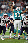 Miami Dolphins defensive tackle Ndamukong Suh (93) leaps while trying to block a pass during the 2017 NFL week 14 regular season football game against the New England Patriots, Monday, Dec. 11, 2017 in Miami Gardens, Fla. The Dolphins won the game 27-20. (©Paul Anthony Spinelli)