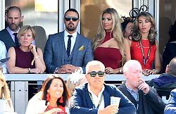 Paddy McGuinness and his wife Christine McGuinness watch the action during Grand National Day of the 2018 Randox Health Grand National Festival at Aintree Racecourse, Liverpool.