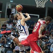 Anadolu Efes's Sinan Guler (L) during their Turkish Basketball League Play Off match Anadolu Efes between Pinar Karsiyakaat Sinan Erdem Arena in Istanbul, Turkey, Sunday, May 06, 2012. Photo by TURKPIX