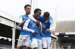 Siriki Dembele of Peterborough United celebrates scoring his goal against Oxford United with team-mate Reece Brown and Jonson Clarke-Harris - Mandatory by-line: Joe Dent/JMP - 17/10/2020 - FOOTBALL - Weston Homes Stadium - Peterborough, England - Peterborough United v Oxford United - Sky Bet League One