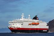 MS Richard With sailing into Herøyfjord, Norway | Hurtigruteskipet MS Richard With seiler inn i Herøyfjord, Norge. Skorpa i bakgrunnen.