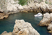 A boat in a rock cove, Croatia, Dubrovnik, the Walled Old City